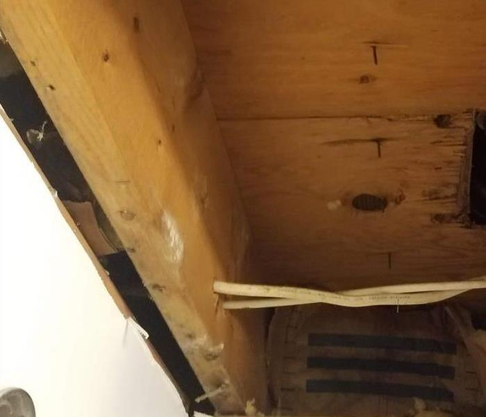 The ceiling has been removed down to the studs and wood has been replaced