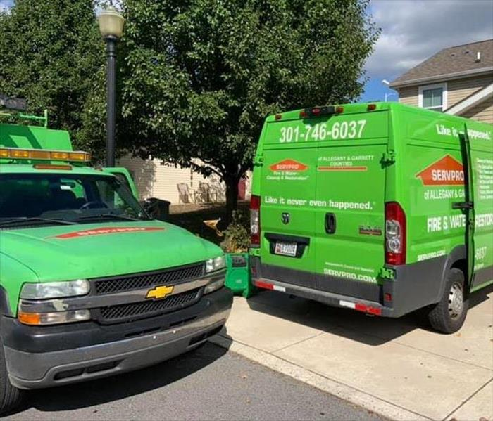 Two vehicles are parked outside of a customer's home